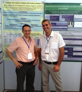 Guy and Patrick posted in front of their posters at the CIPP XI in Bangkok